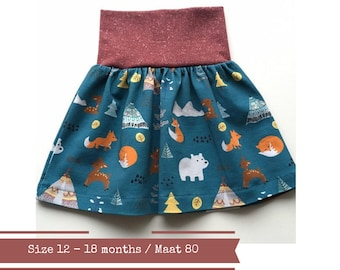 Petrol baby or toddler skirt with forest animals. Size 12 - 18 months
