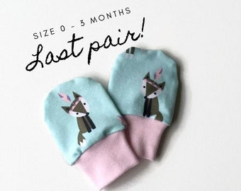 Mint baby mittens with foxes