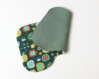 Baby burp cloth of green cotton with apples