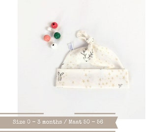 Off white organic baby knot hat with stars, cats and deer. Size 0 - 3 months