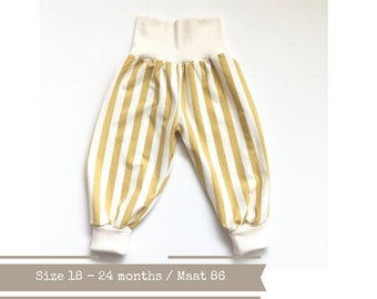 White and yellow bubble pants with stripes. Size 18 - 24 months. Organic