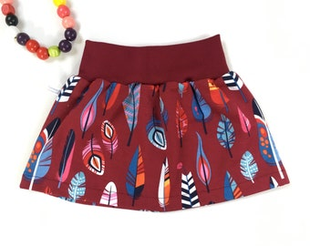 Burgundy skirt with feathers