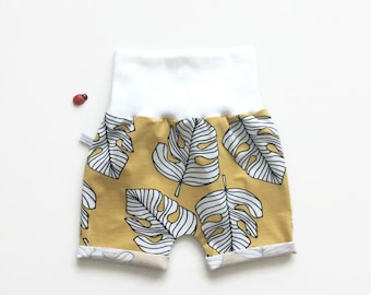 Yellow baby or toddler shorts with tropical leaves