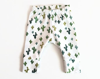 White baby leggings with cactuses