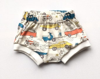 Off white baby or toddler shorts with retro cars