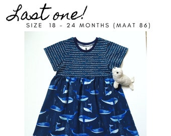 Blue girl's dress with whales