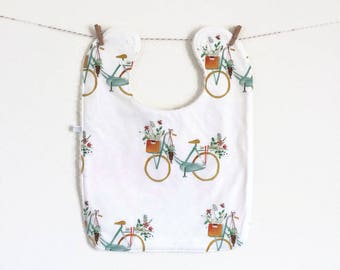 Large baby or toddler bib. White cotton with bicycles. White cotton terry back. Bikes baby bib. Flowers and basket on bicycle