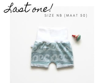 Mint baby or toddler shorts with white waves