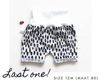 White baby or toddler shorts with black dots