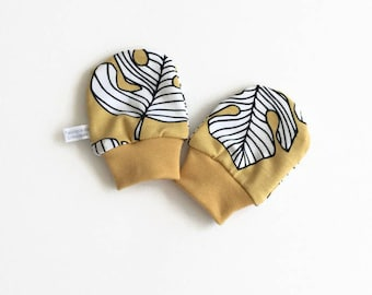 Yellow baby mittens, baby scratch mitts. Organic jersey cotton knit with monstera leaves. Baby Gift Boy or Girl Hand Covers. Gender neutral