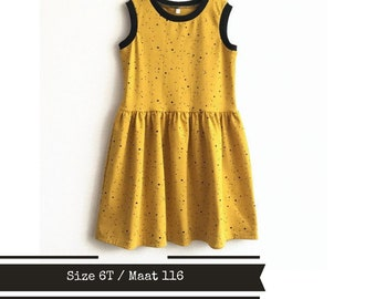 Yellow girl's dress with black dots. Size 6T