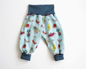 Baby pants with little monsters and dots