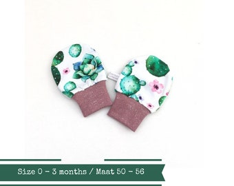 White baby scratch mitts with cactuses. Size 0 - 3 months