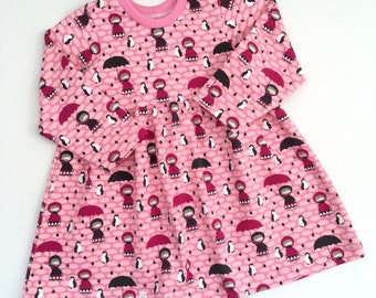 Pink dress with girls, penguins and small clouds