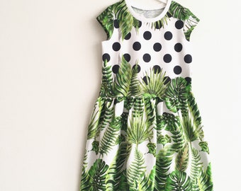 Dress with black dots and leaves