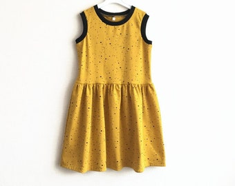 Yellow girl's dress with black dots