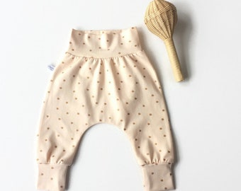 Peach baby harem pants with gold dots