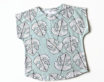 Mint green t-shirt with tropical leaves