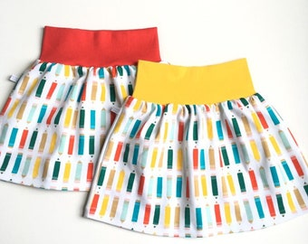White baby or toddler skirt with colourful pencils