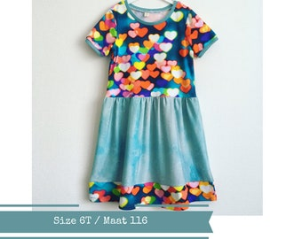Girls dress with colourful hearts. Size 6T