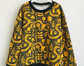 Yellow sweater with pirate maps