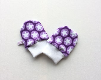 Purple baby mittens with white stars