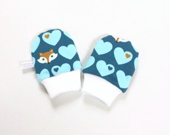Blue scratch mitts with foxes and hearts