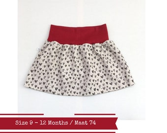Last one: Beige baby or toddler skirt with hearts.  Size 9 - 12 months.