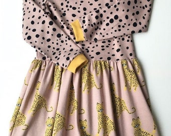Girl's dress with leopards and dots. Organic cotton