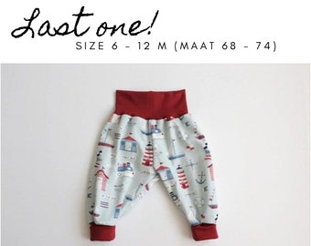 Light blue bubble pants with lighthouses, boats, fish. Size 6 - 12 months. Slouchy infant pants with red fold over waistband and cuffs.