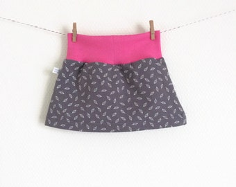 Grey baby or toddler skirt. Pink waist band. Grey skirt with small white leaves. Sizes 3 Months - 4T. Girl's skirt, small skirt.