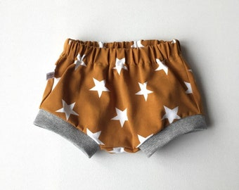 Yellow baby or toddler shorts with stars