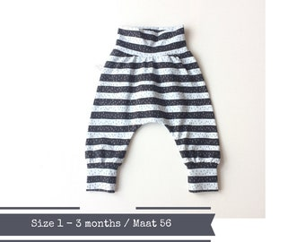 Baby or toddler harem pants with black and light grey stripes. Size 1 - 3 months