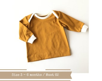 Yellow baby lap neck shirt. Size 3 - 6 months. Yellow shirt with off white ribbing