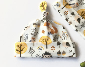 Yellow hat with woodland animals