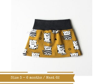 Yellow baby skirt with cats. Size 3 months