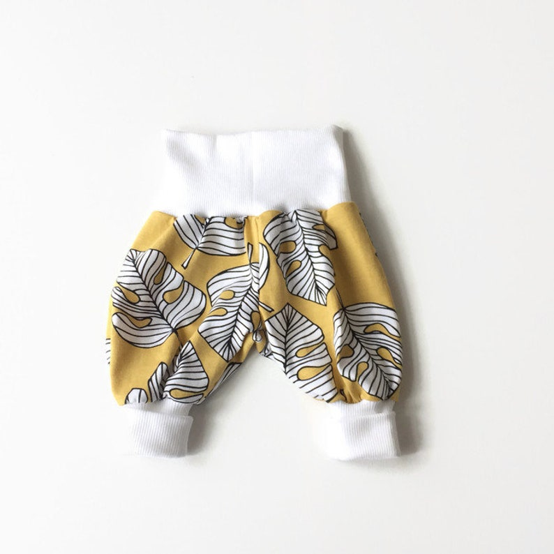 Harem pants with white fold over waistband and cuffs Organic cotton Comfy slouchy infant pants Yellow bubble pants with plant leaves