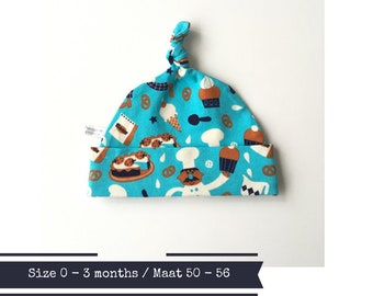 Blue hat with bakers and cakes. Size 0 - 3 month