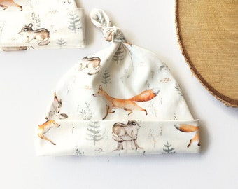 Off white hat with woodland animals