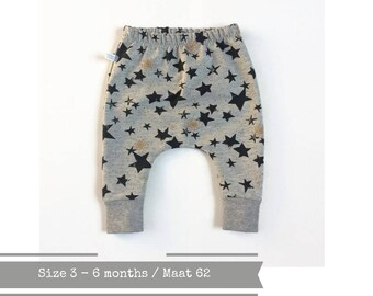 Grey baby harem pants with black and gold stars. Size 3 months
