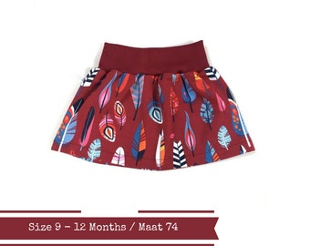 Burgundy baby or toddler skirt with feathers. Size 9 Months
