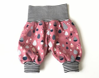 Pink baby pants with raindrops