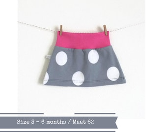 Grey skirt with white dots and pink waist band. Size 3 - 6 months