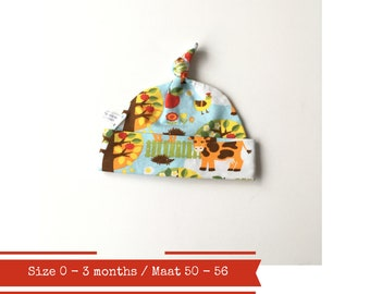 Blue hat with cows and trees. Size 0 - 3 months