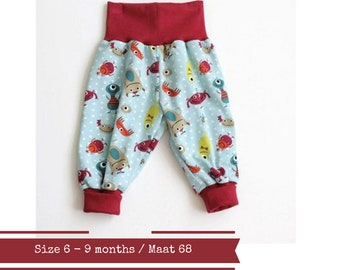 Last one: Baby harem pants. Size 6 - 12 months. Green bubble pants with little monsters and dots