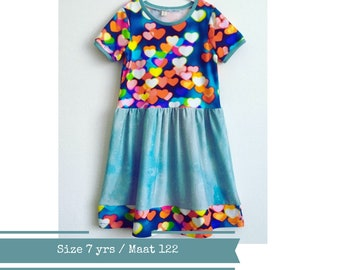 Girls dress with colourful hearts. Size 7