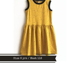 Yellow girl's dress with black dots. Size 6