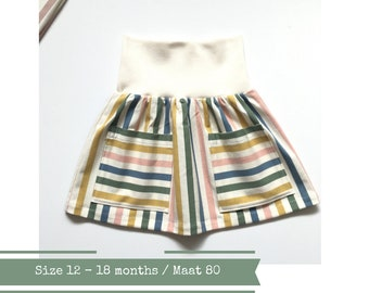 Off-white baby or toddler skirt with stripes. Size 12 - 18 months. Organic cotton knit