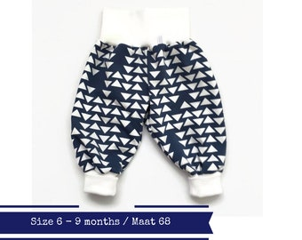 Last one: Blue harem pants with white triangles. Size 6M. Slouchy infant pants. Fold over waistband and cuffs. Blue cotton knit