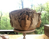 Four faced bowl